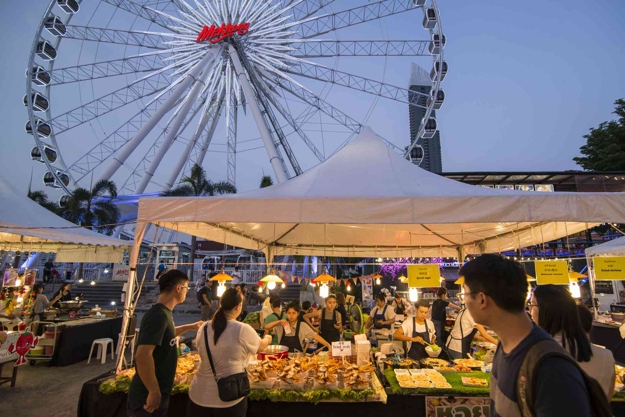 The Ferris Wheel of the Asiatique Riverfront Nightmarket in the city of Bangkok in Thailand