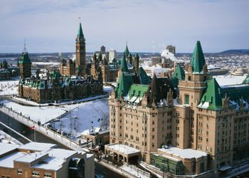 Ottawa's Chateau Laurier Hotel and Parliament Buildings in Winter