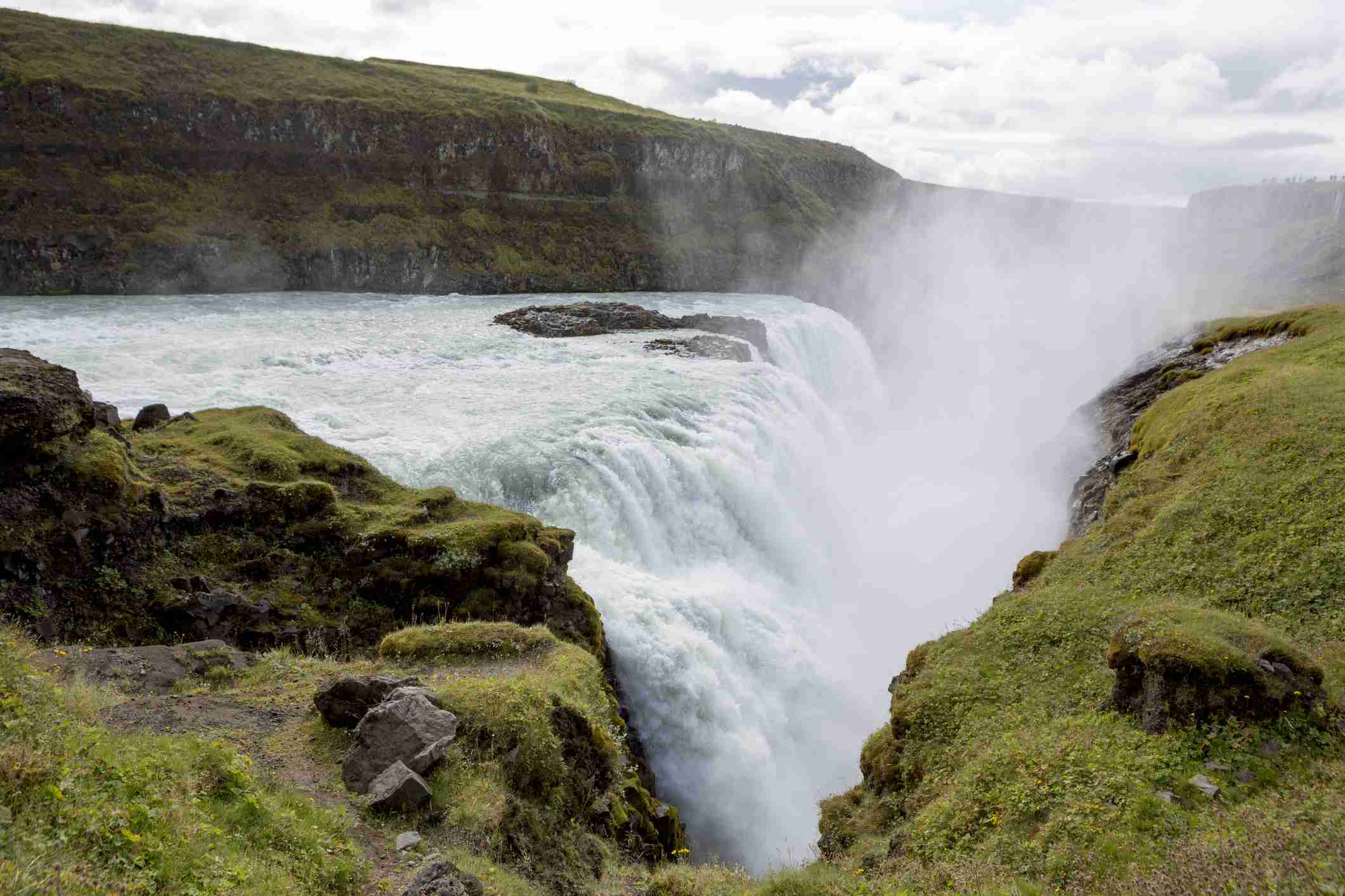 Iceland's rugged terrain and natural wilderness beauty. Gullfoss waterfall in Iceland is a internationally famous landmark, located on the Golden Circle.