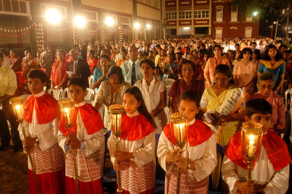midnight christmas mass being held at the grounds of a school in mazgaon mumbai