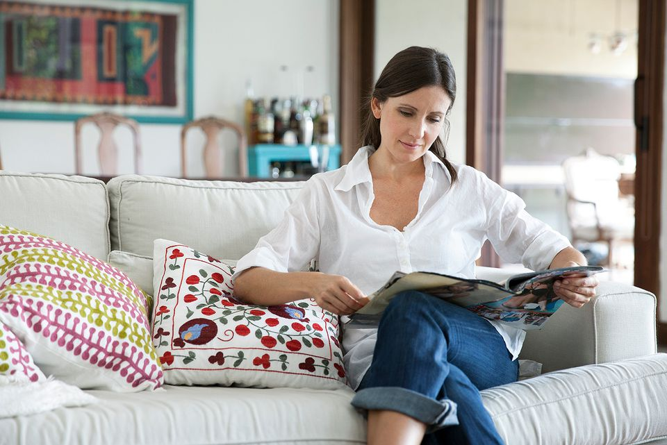 Woman reading a magazine.