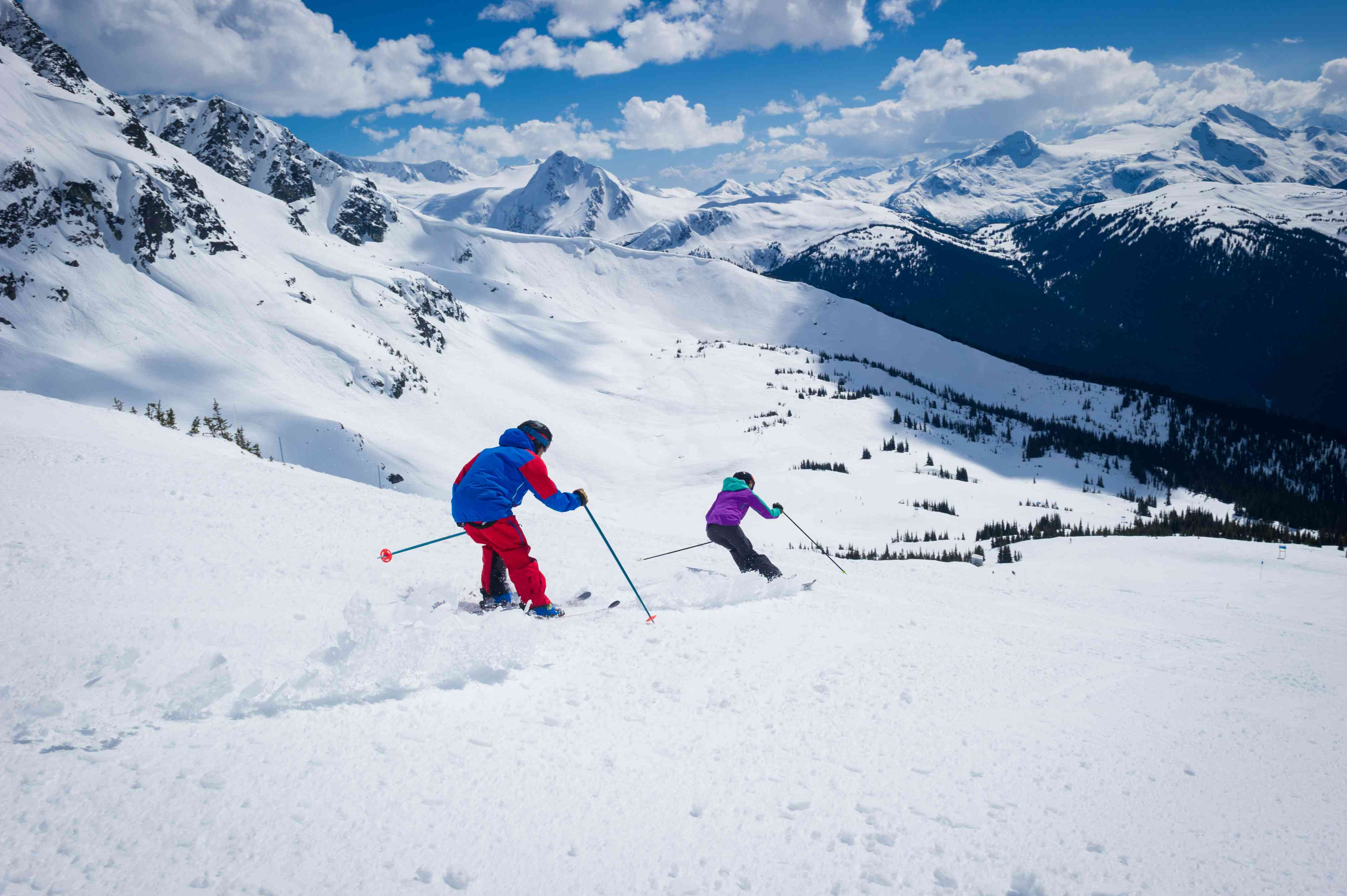 Couple spring skiing in Canada mountains