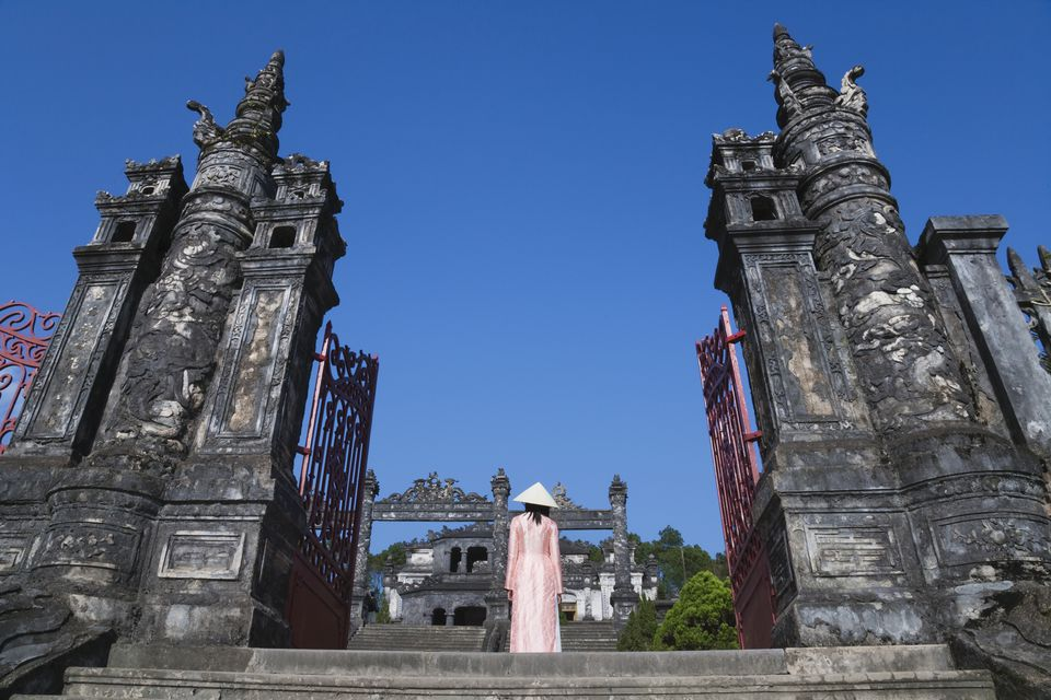 Visitor in ao dai ascending Khai Dinh's tomb