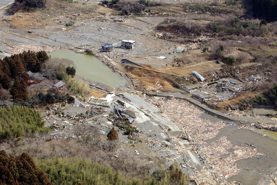 An aerial view of Minato, Japan after a 9.0 earthquake and tsunami.