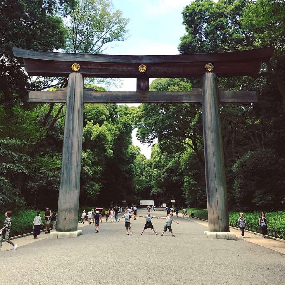 three chindren underneath the Meiji-Jingu temple gate