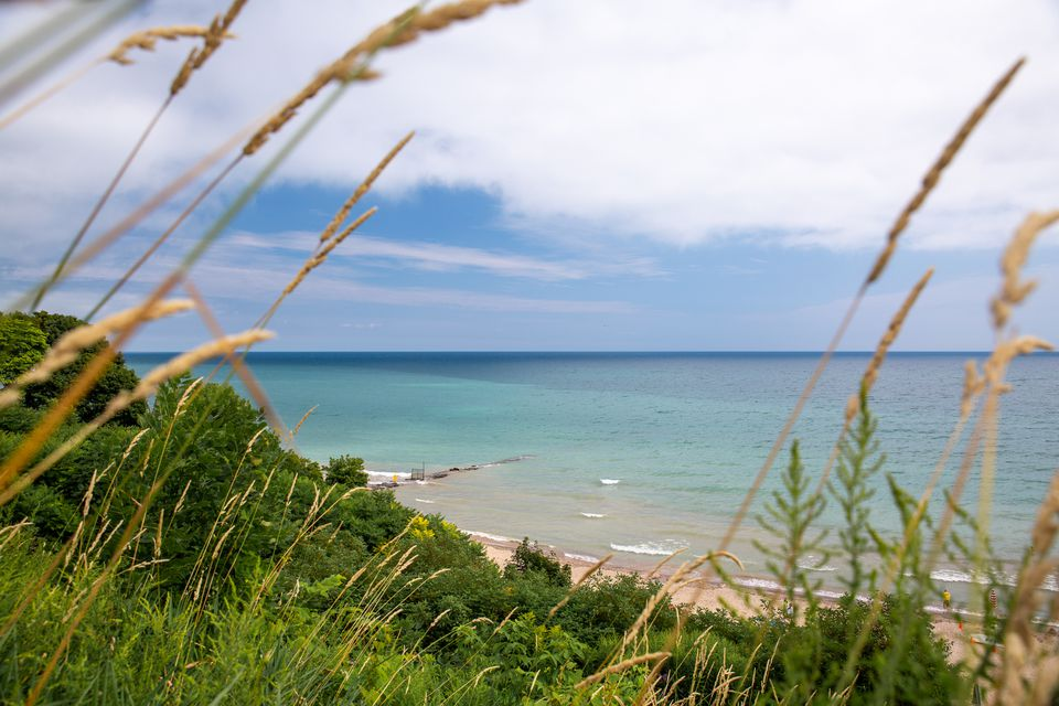 View of Atwater beach through the grassy dunes