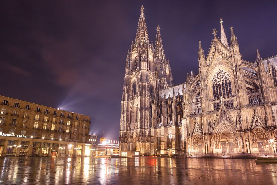 Low Angle View Of Illuminated Cologne Cathedral Against Sky At Night