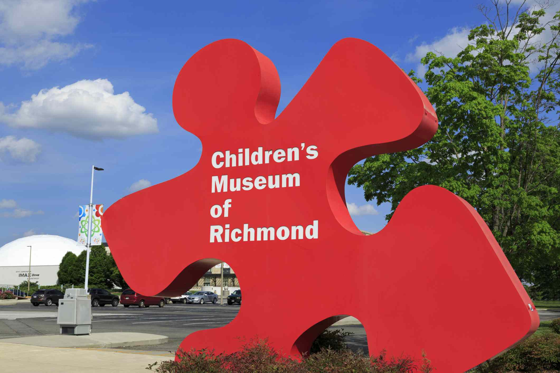 red puzzle piece-shaped sculpture that says