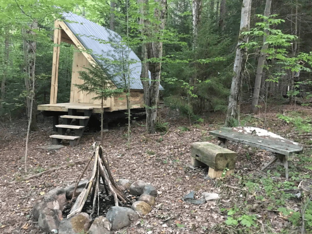 Cabin and fire pit at Fern Valley Eco-