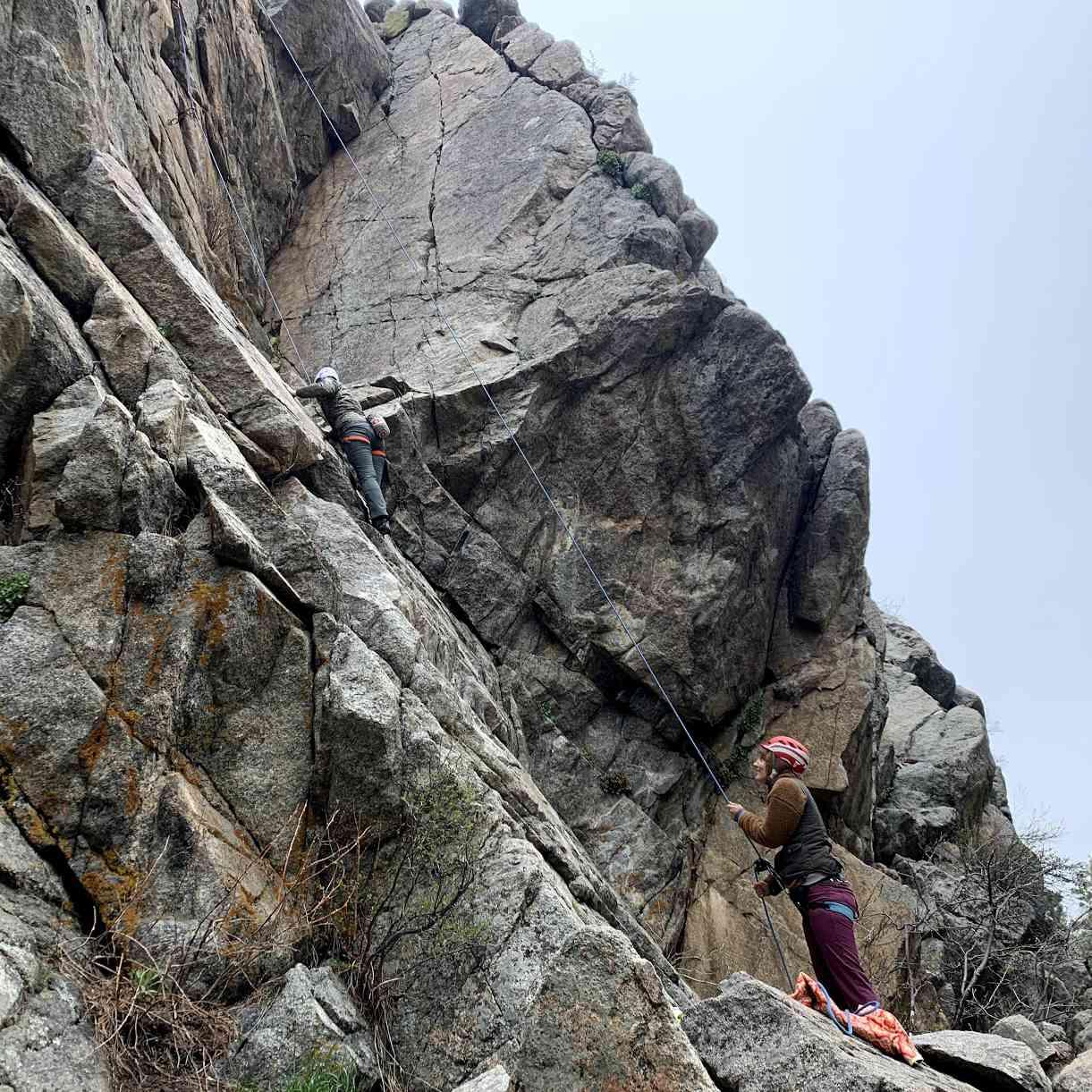 Author climbing while partner belays