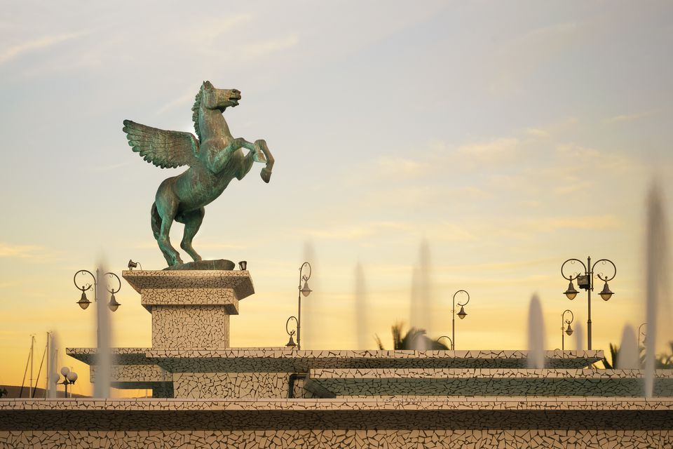 Statue of Pegasus in the central square of the Greek city of Corinth