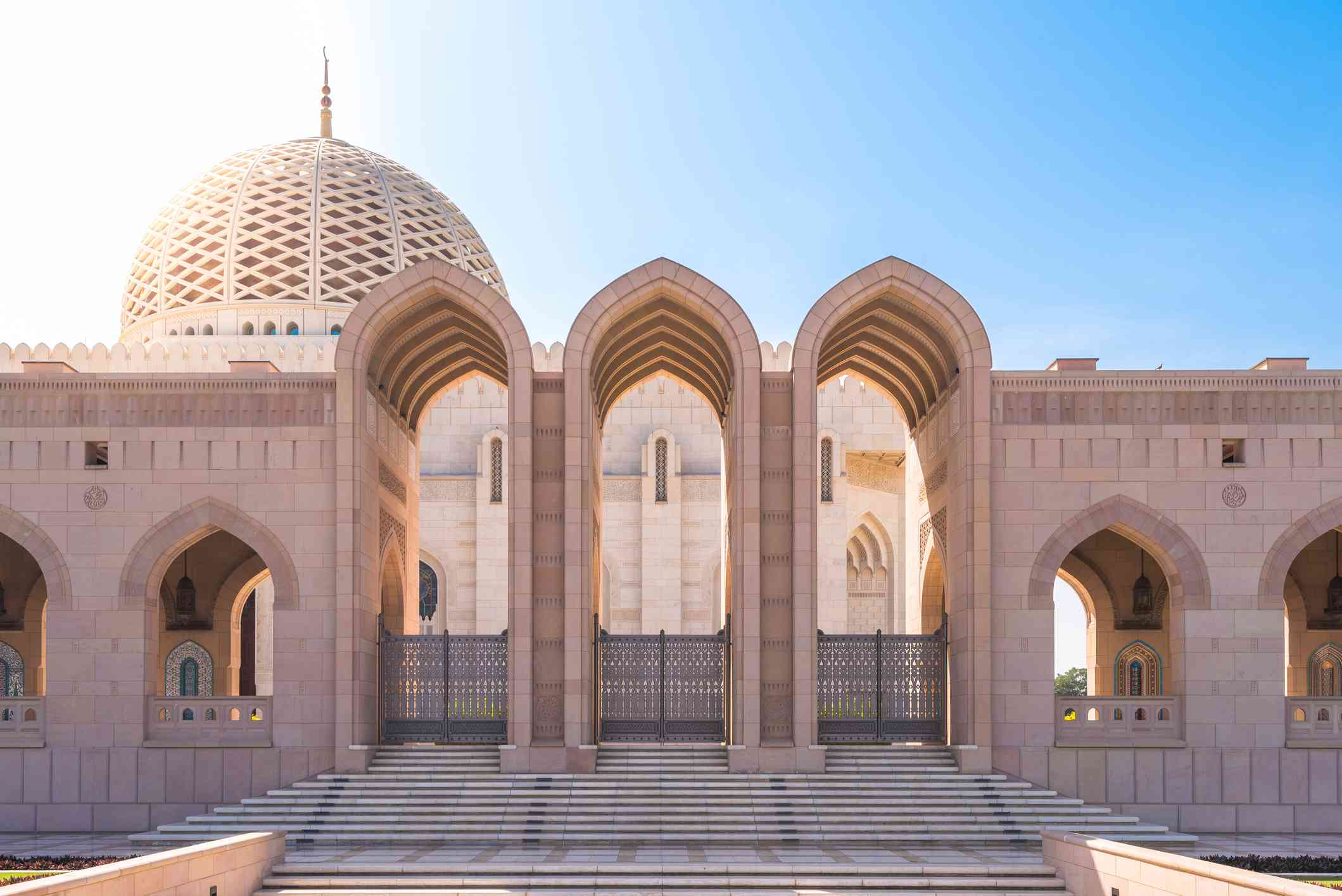 Steps, arches and dome of Sultan Qaboos Grand Mosque in Muscat, Oman