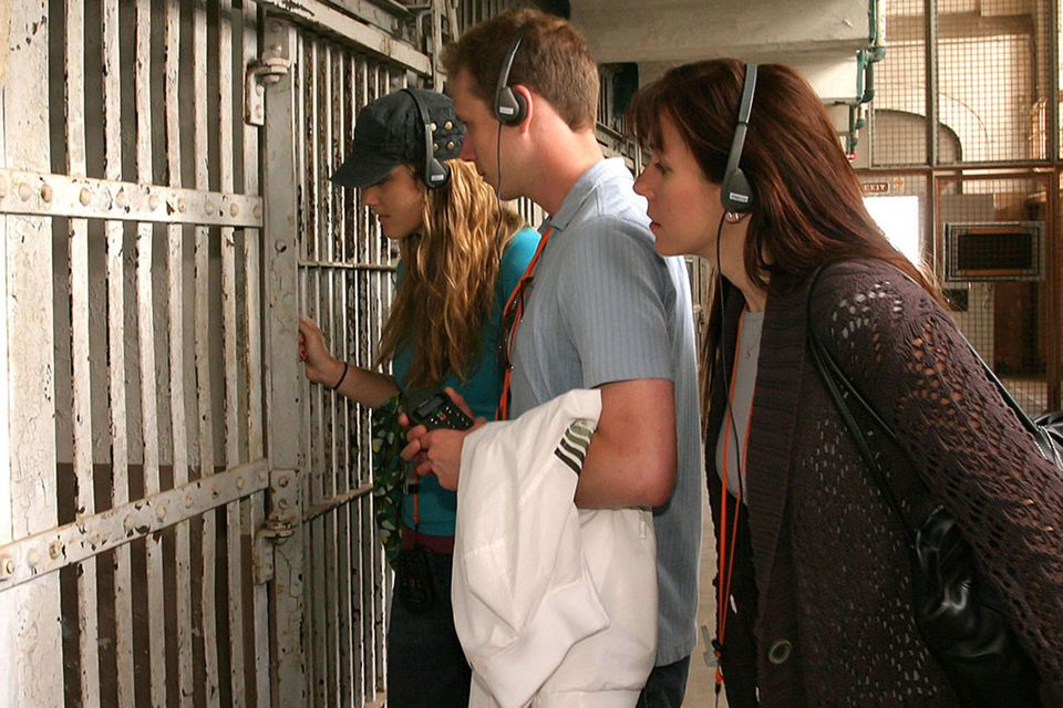 three people taking the Audio Tour at Alcatraz