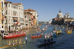 Grand Canal Venice Italy. Regatta Regata Storica procession of boats down the Grand Canal annually first Sunday in September. Church Santa Maria della Salute
