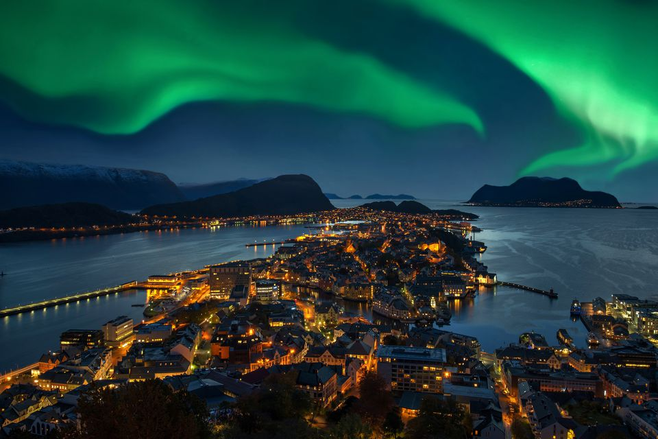 Green Aurora borealis over Alesund, Norway