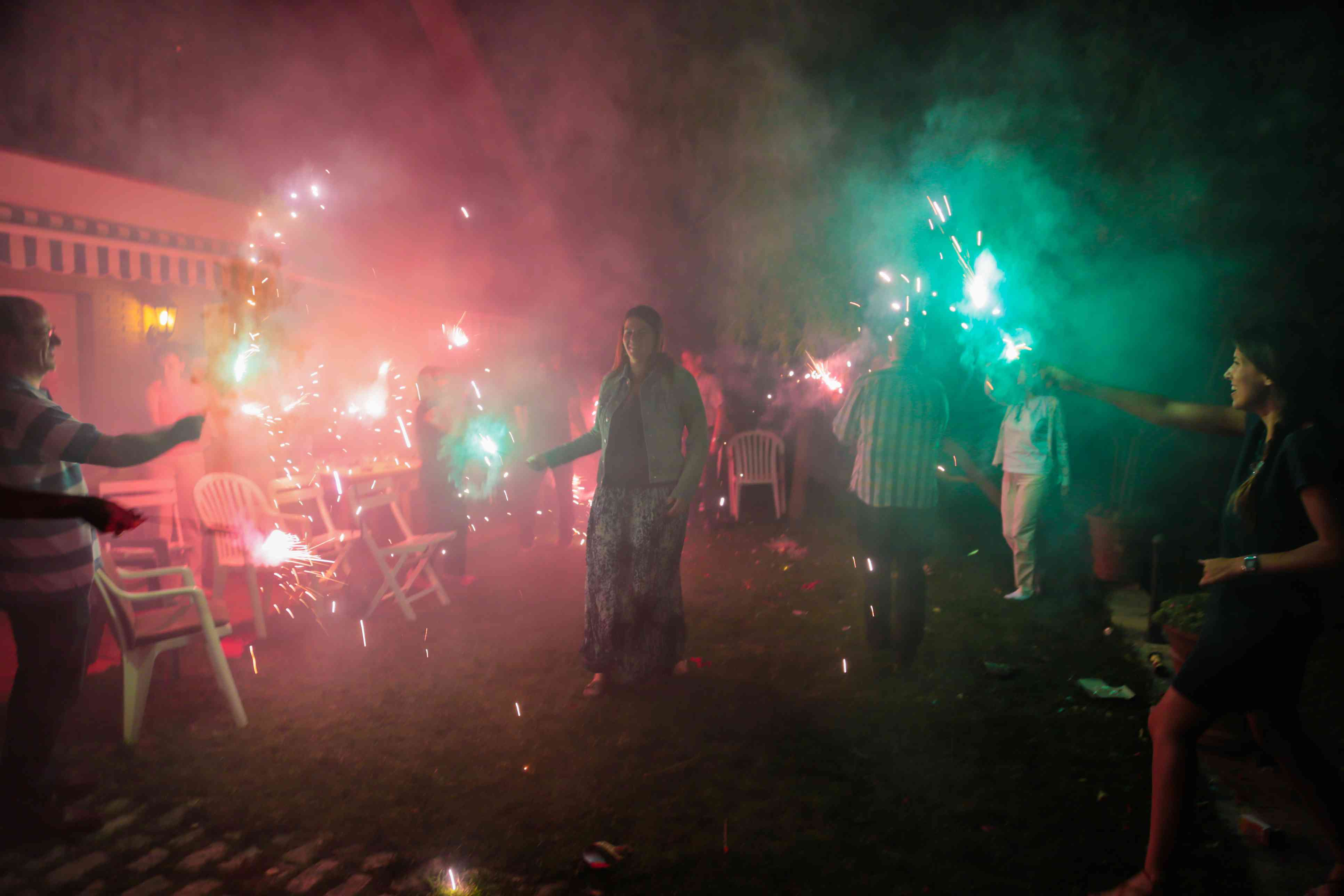 Family with sparklers celebrates summer solstice.