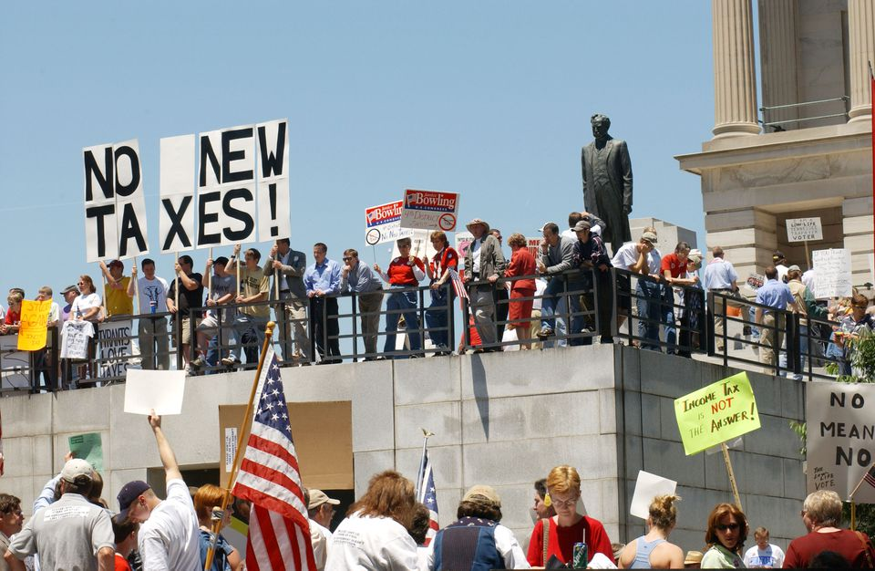 Demonstrators protest at the Tennessee State Capitol against legislation to impose state income tax