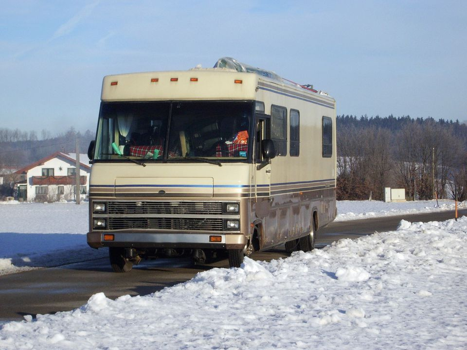 Winter View Of Snow Covered Road With American Motorhome Recreational Vehicle