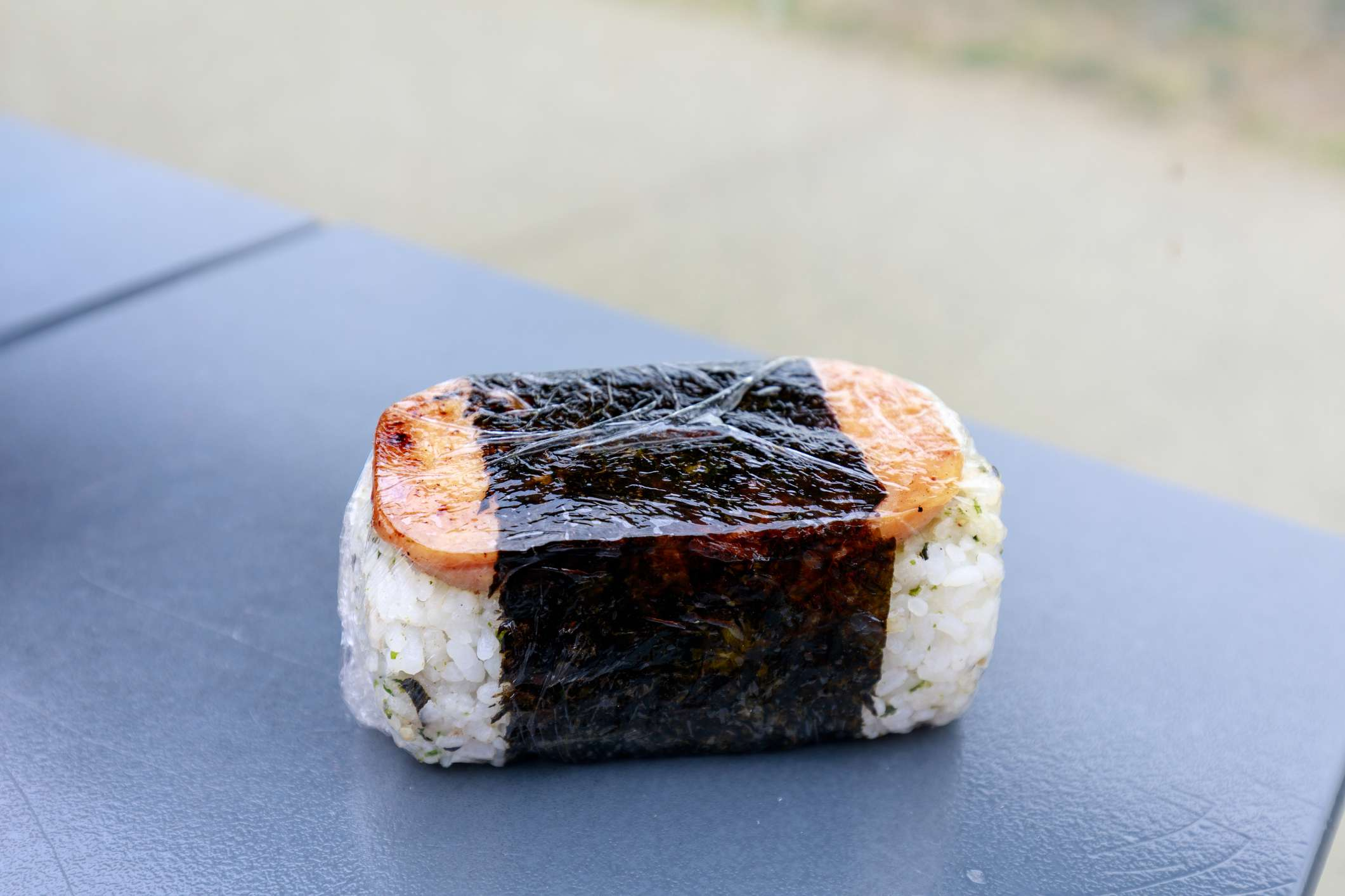 Spam musubi wrapped in plastic