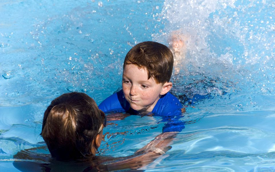 Child Learning to Swim, Boy Swimming & Teaching Instructor in Pool