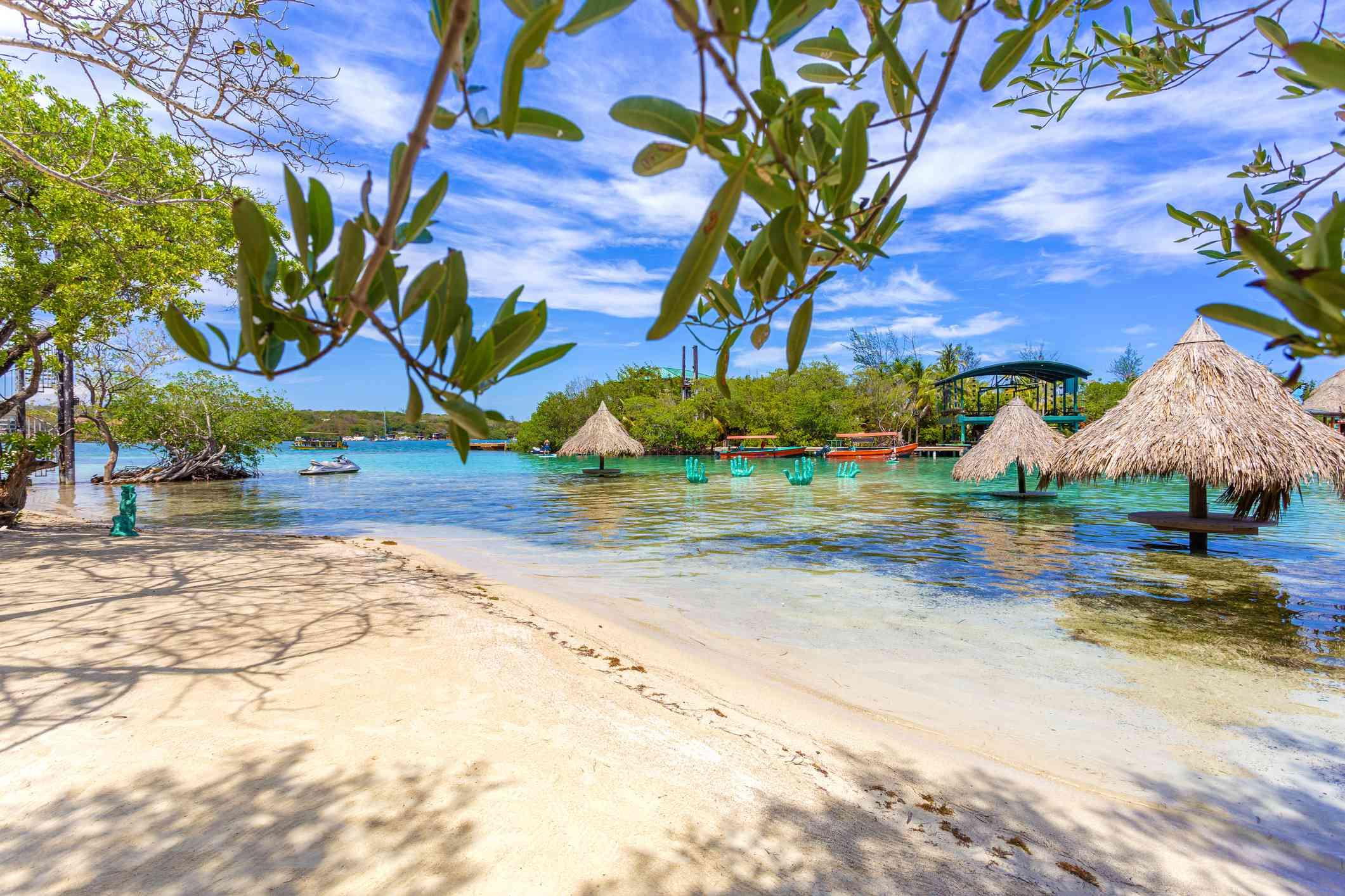 Idyllic transparent water beach in the caribbean sea in a sunny day, Roatan.
