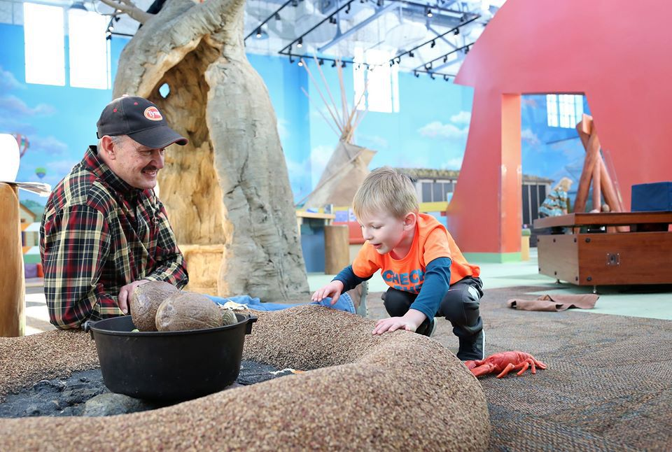 Man and child playing on an installation at Children's Museum of South Dakota