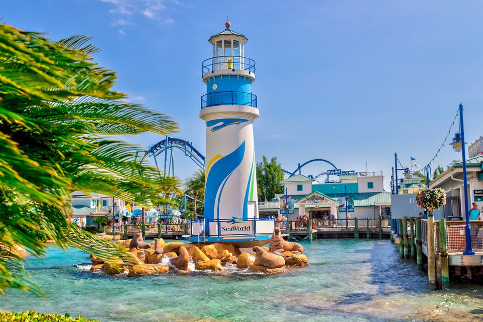 A lighthouse sculpture in a lagoon at SeaWorld, Orlando