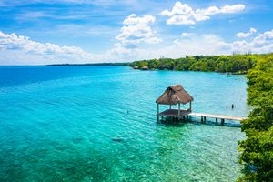 Thatch cabin at the paradise white sand beach of Bacalar, Mexico