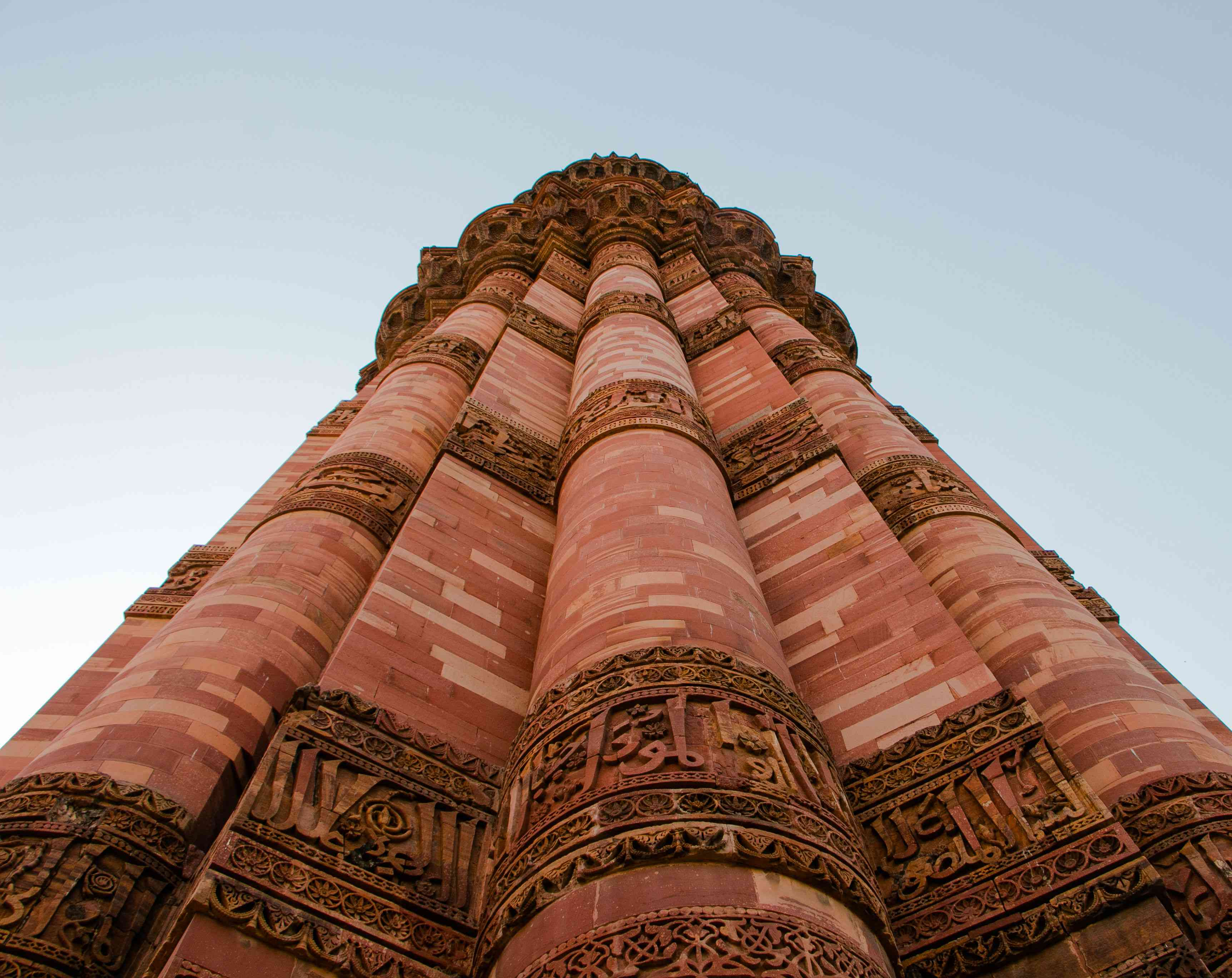 looking up at the Qutab Minar