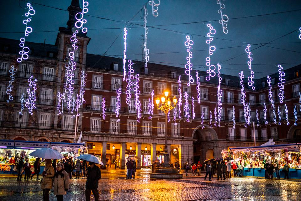People buying gifts at the Plaza Mayor Christmas Market, Madrid