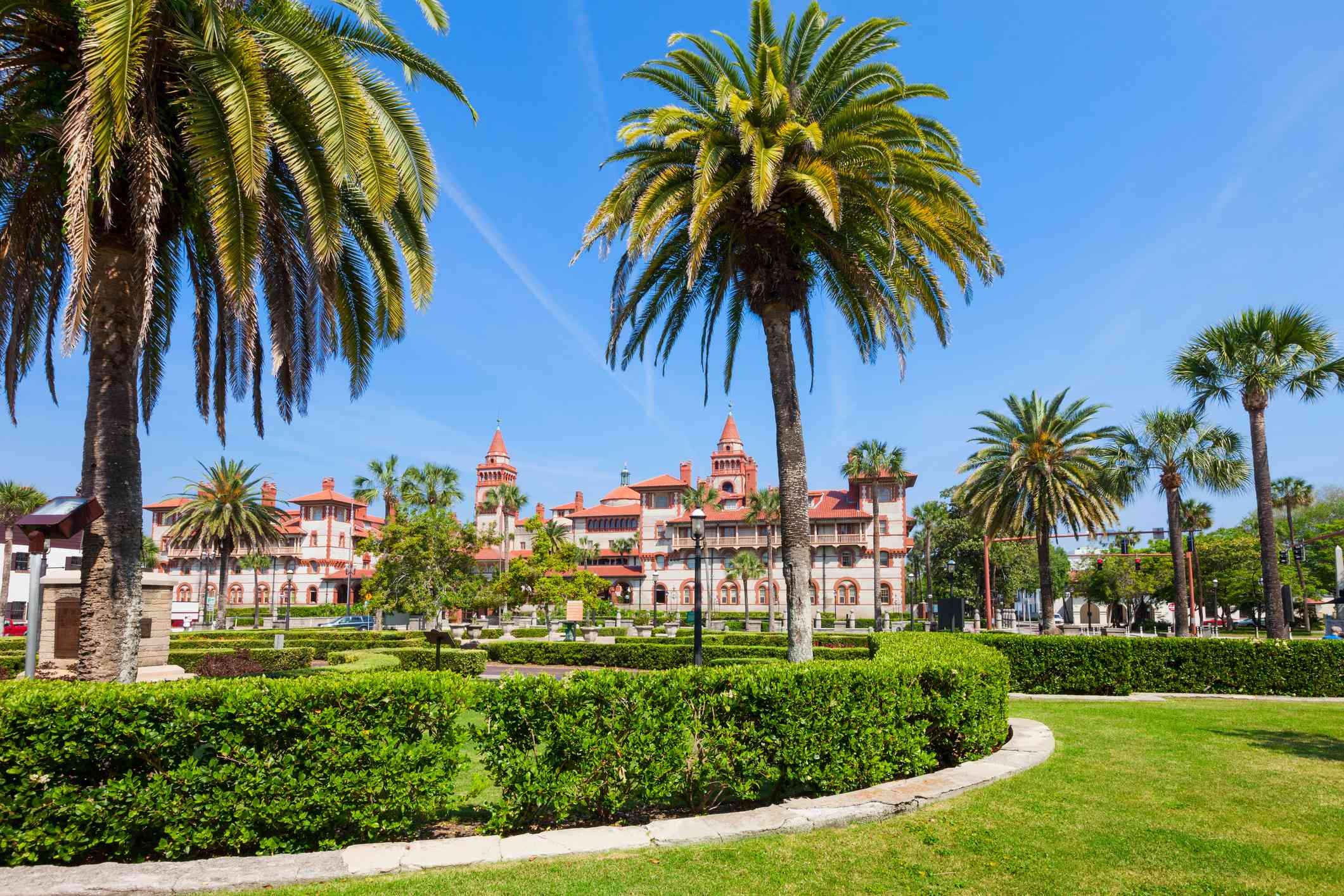 Beautiful park in downtown St Augustine, Florida with the Flagler College main building in the background