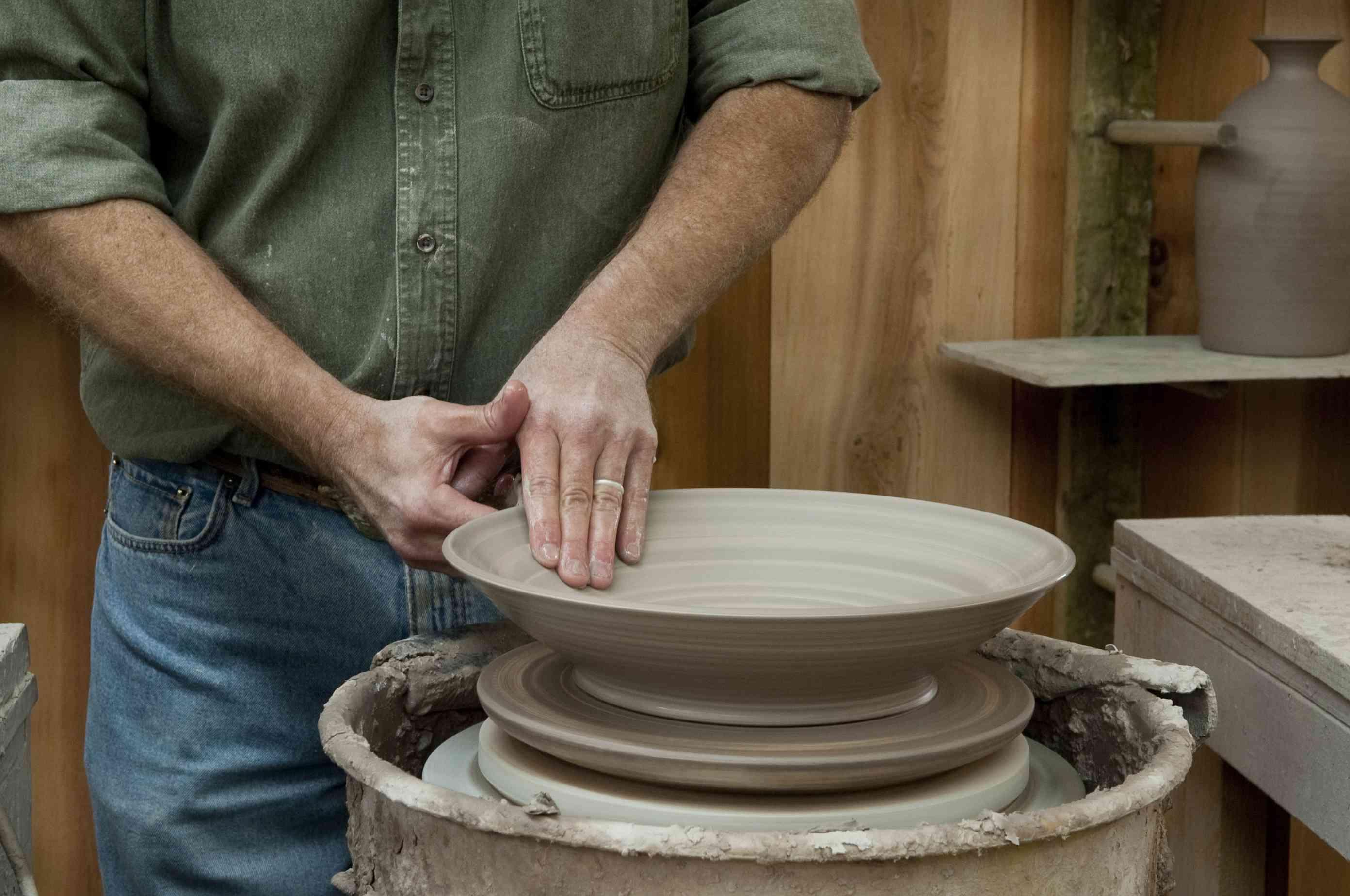 An artisan making pottery in Gatlinburg