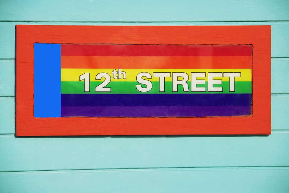 signboard on a gay flag background,12Th Street,Miami Beach,