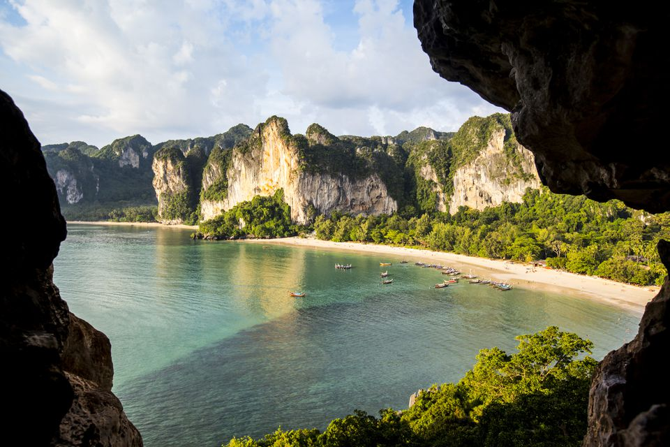 Beach with long-tail boats in Thailand.