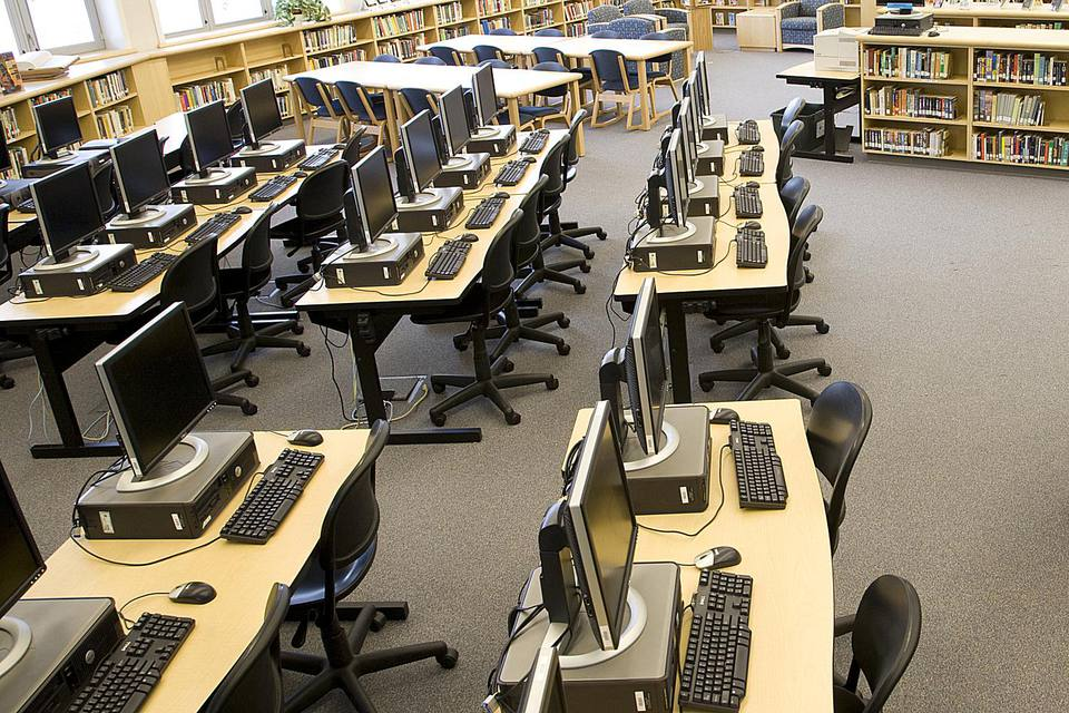 Use computers for free at local libraries.
