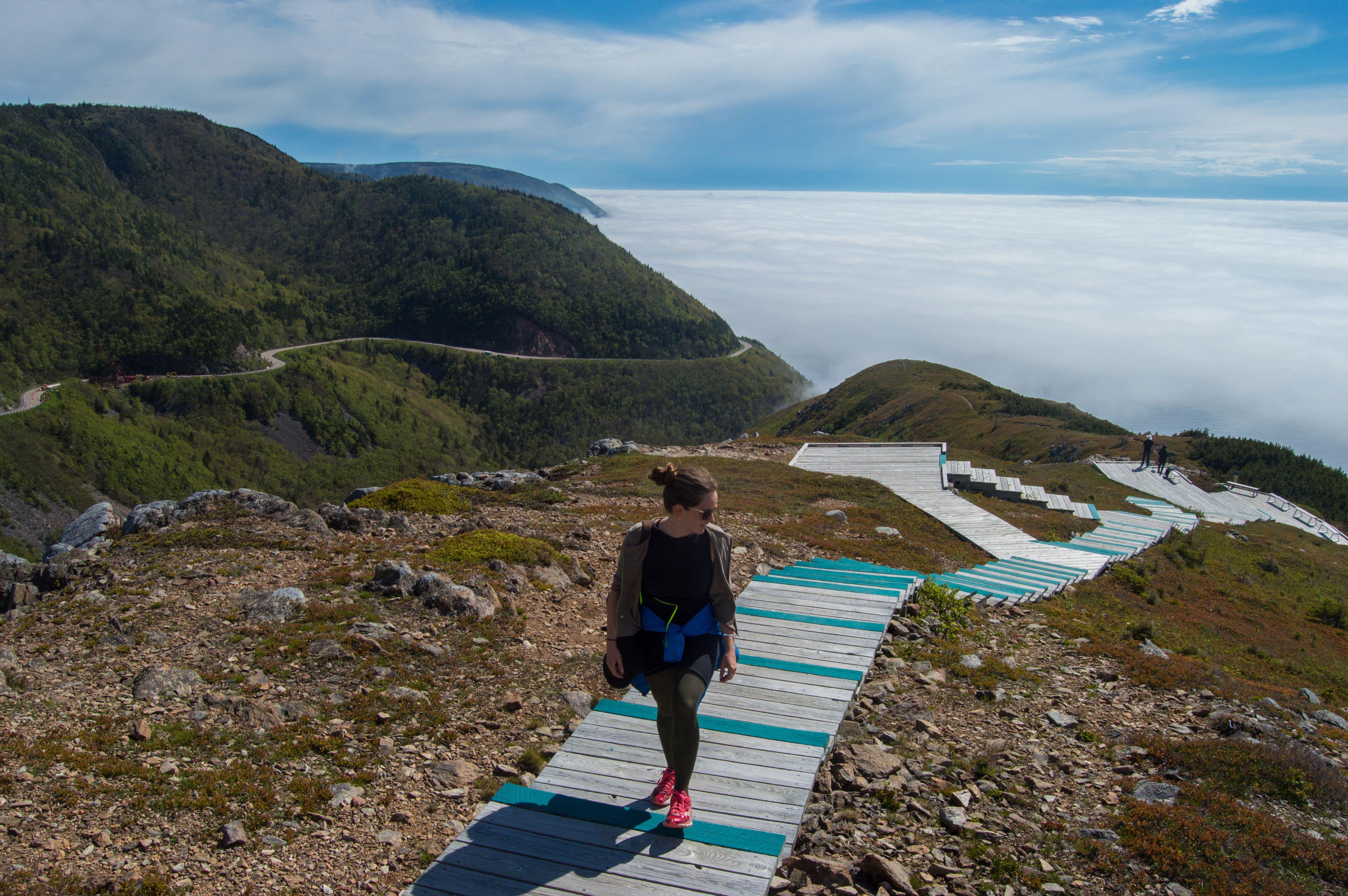 Full Length Of Female Hiker Walking On Steps At Cabot Trail