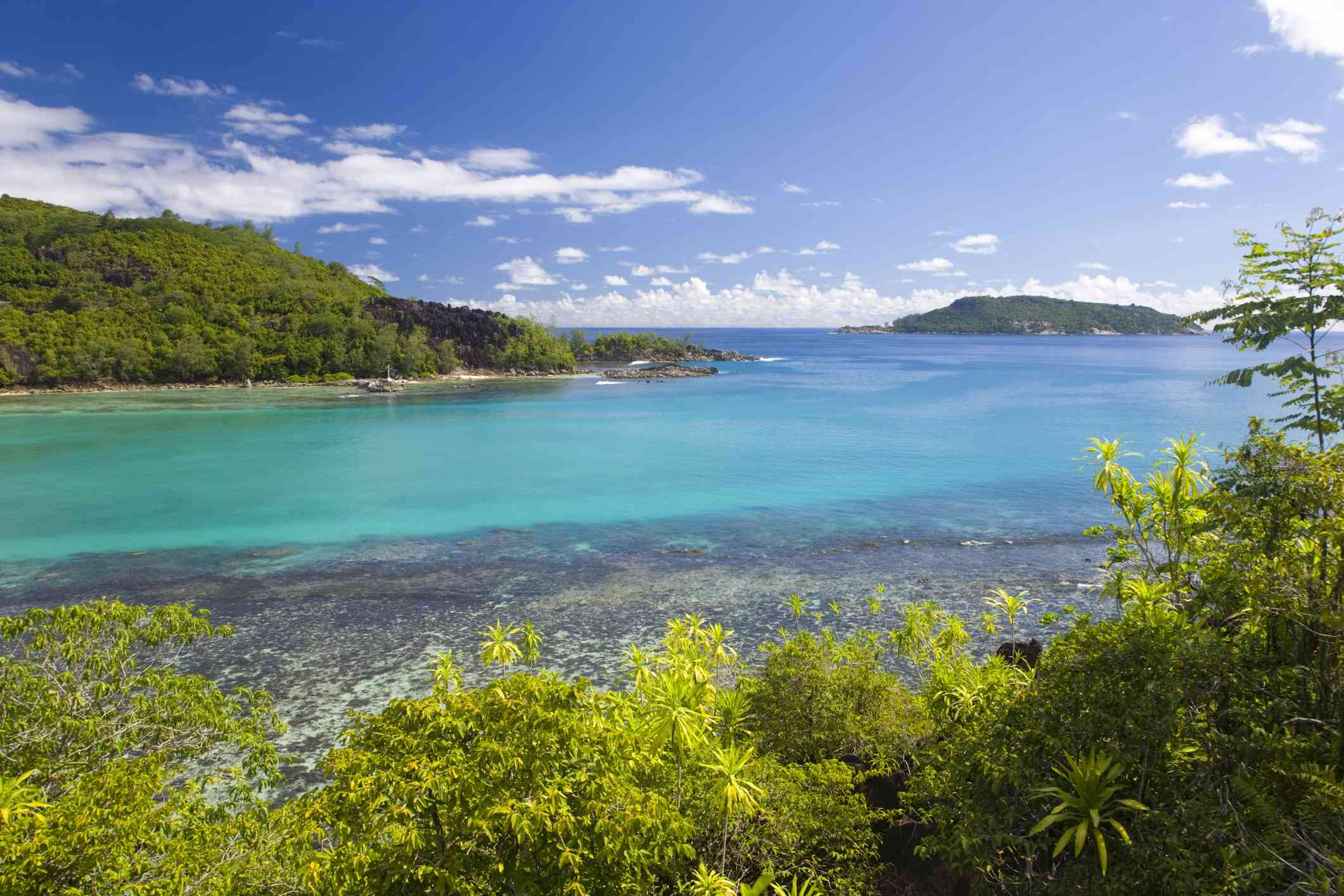Turquoise waters of Port Launay Marine National Park, Port Glaud district.