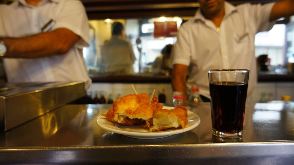 Glass of Spanish vermouth and fried cod at Casa Labra, Madrid