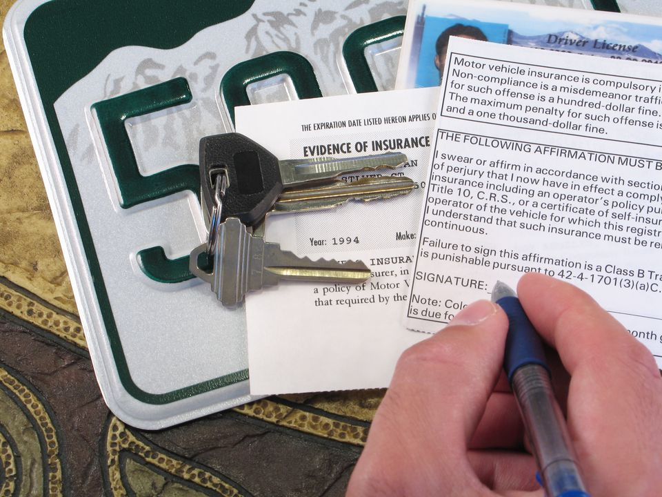 Someone signing a car registration