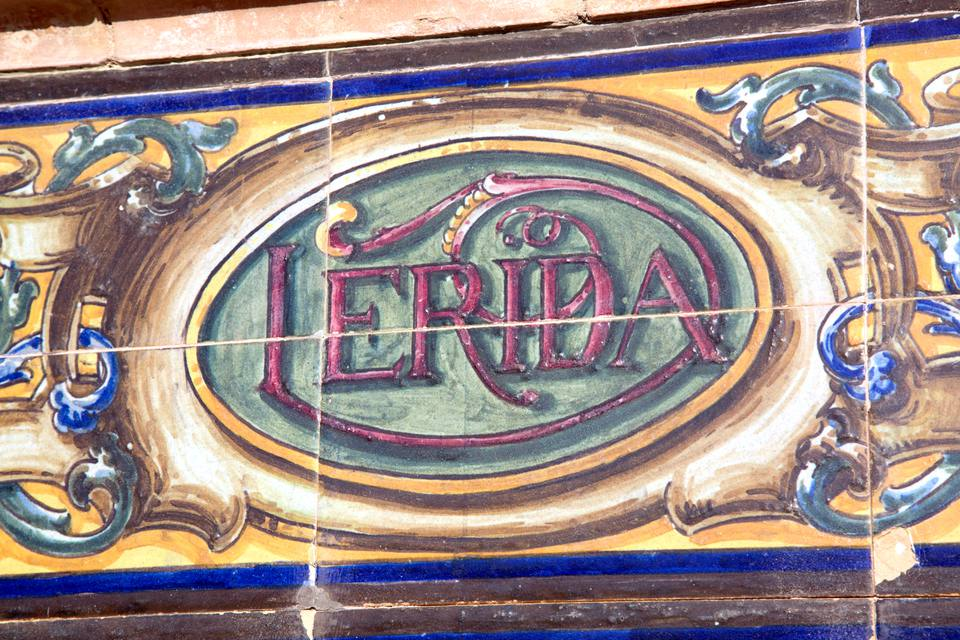 Hand painted Spanish tiles in Seville point the way toward Lleida, known as Lerida in Spanish