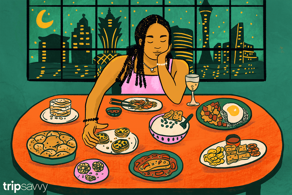 Illustration of writer sitting a table filled with food with the Macao skyline behind her