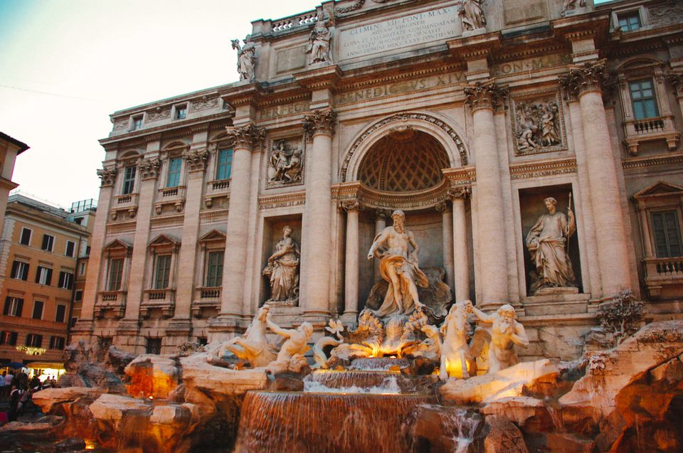 The trevi fountain lit up at night