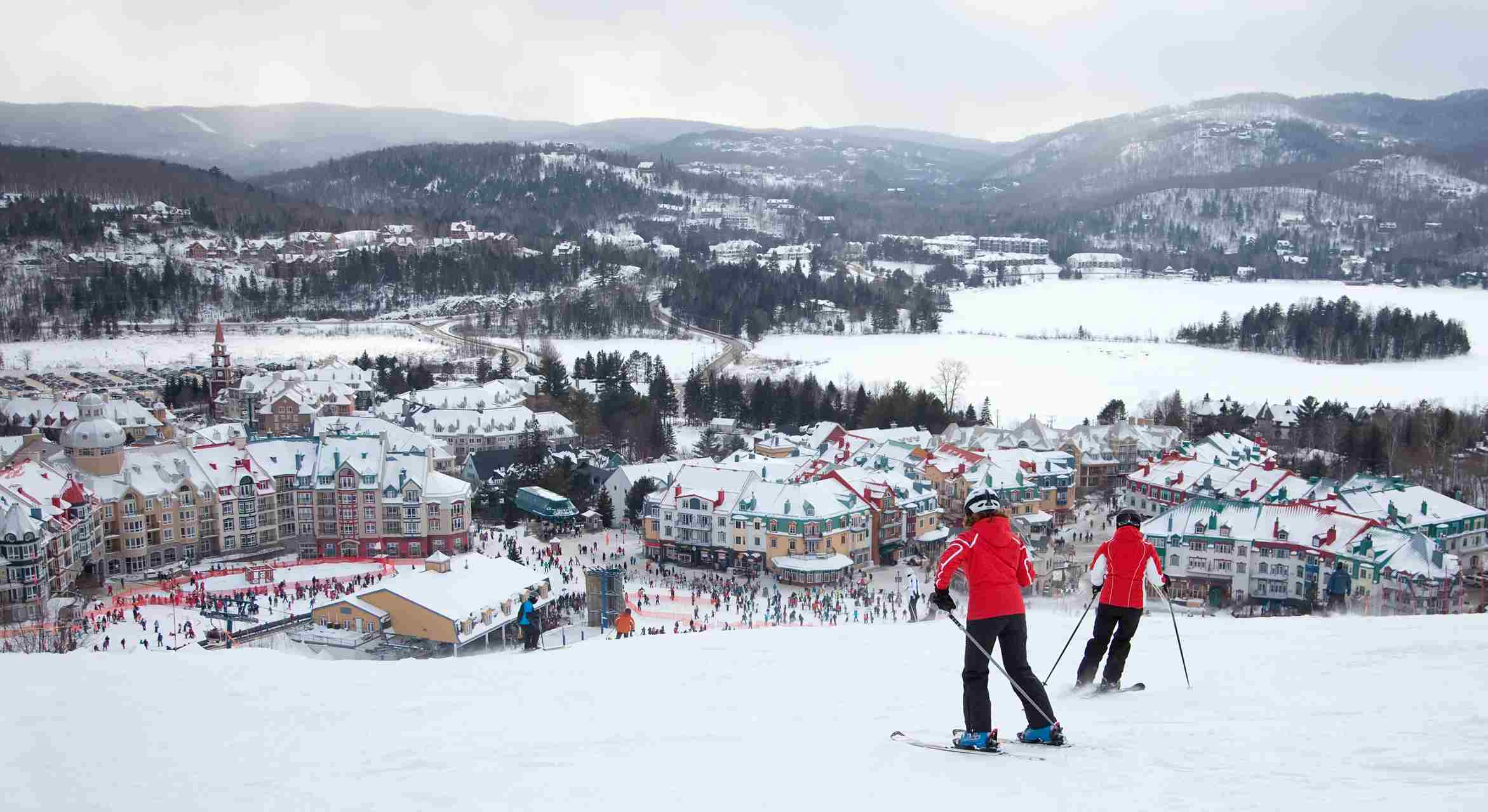 Skiers going down the main slope at Mont-Tremblant Ski Resort