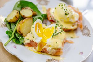 Eggs Benedict close up, high angle view