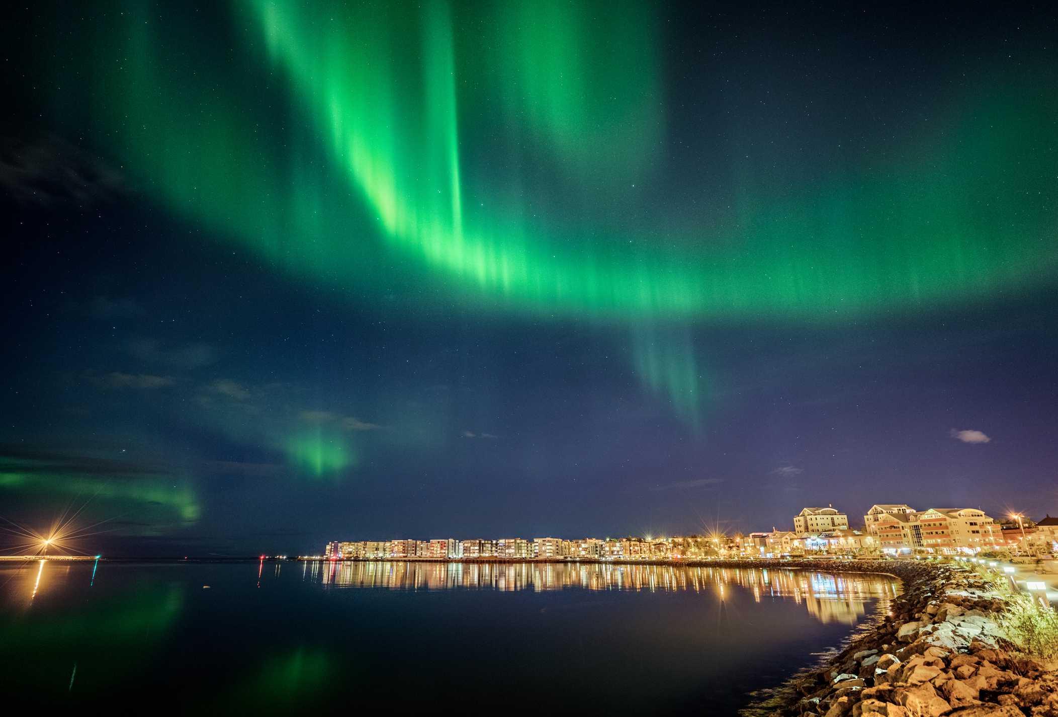Northern Lights over Reykjavik Harbor