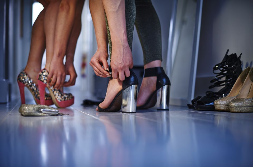 Women putting on high heels ahead of a night out