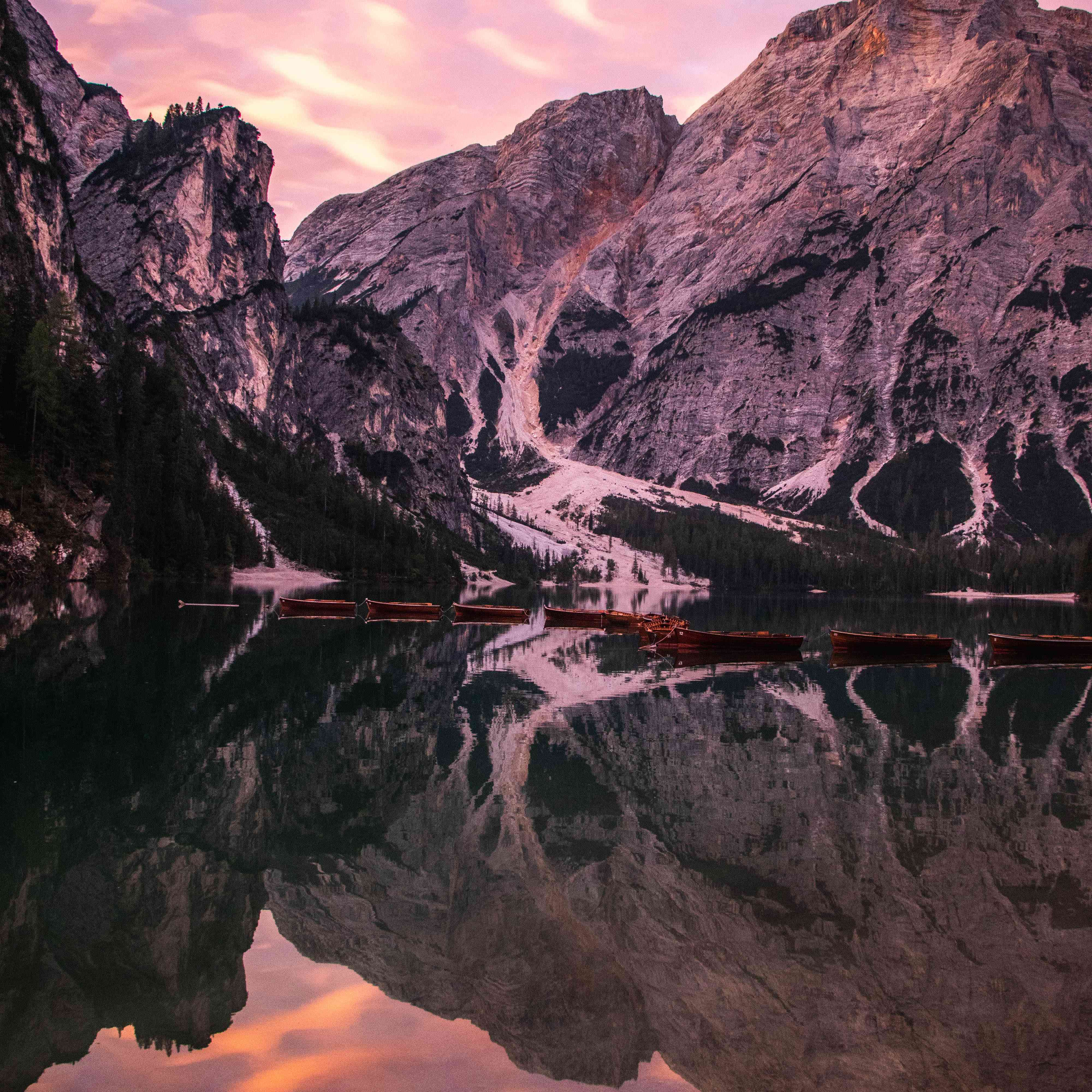 A sunset over a lake in the Dolomites