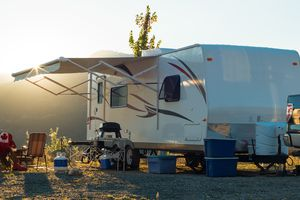 White recreational vehicle parked up at sunset