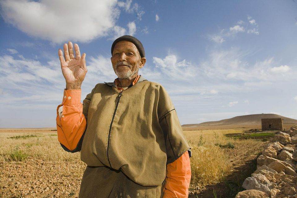 Moroccan Herdsman Waving Hello