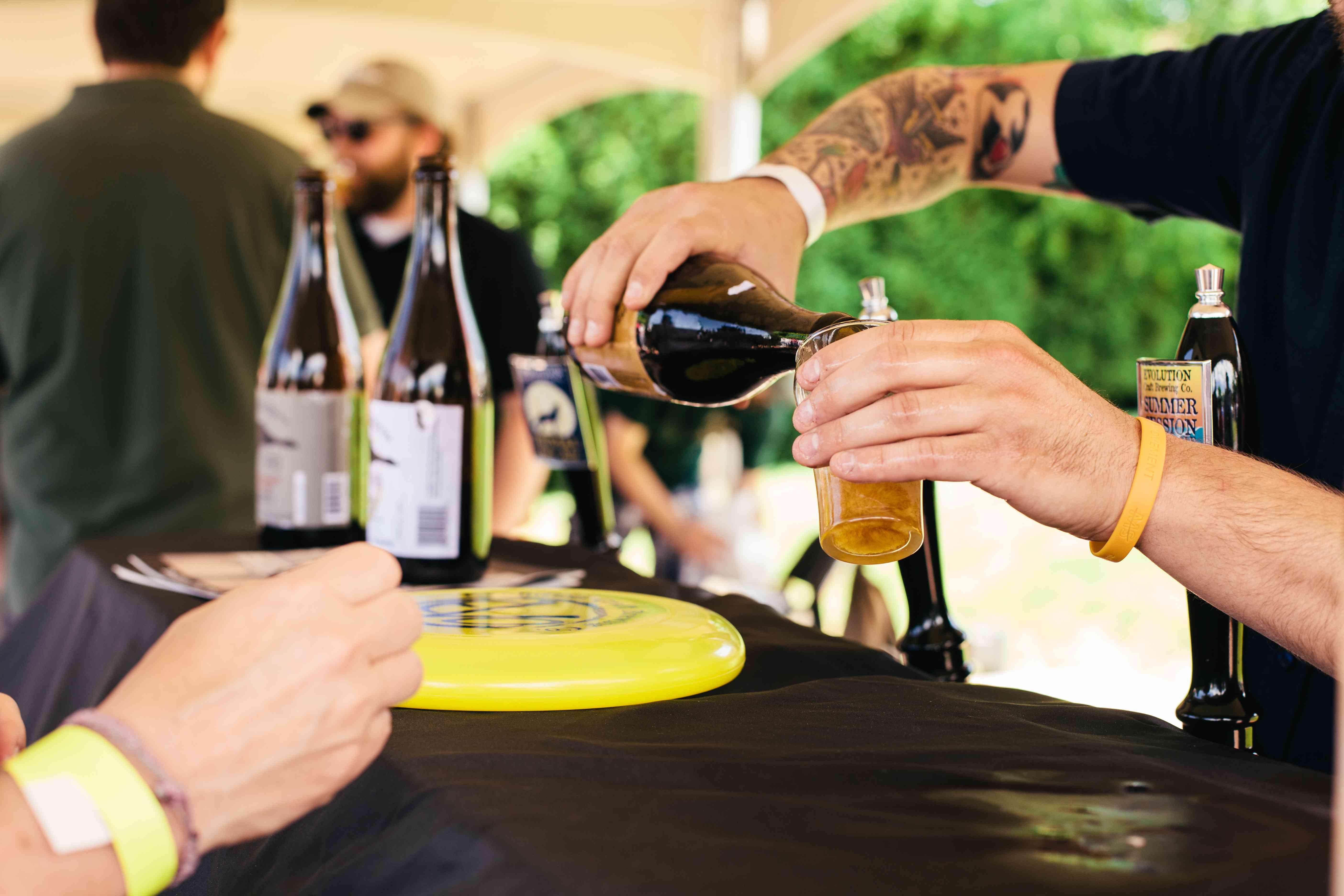 Bertender pouring beer